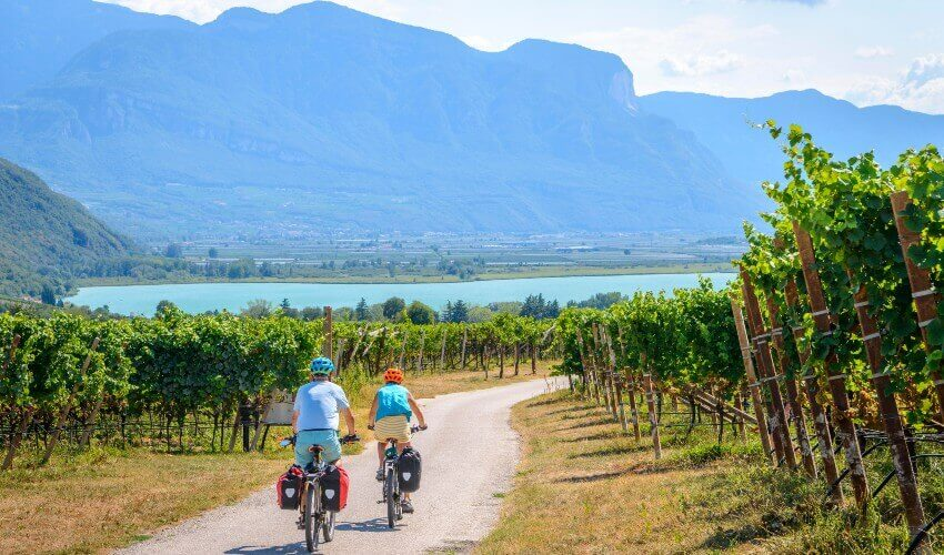 Two cyclists on the Via Claudia Augusta cycle path in South Tyrol, Italy.